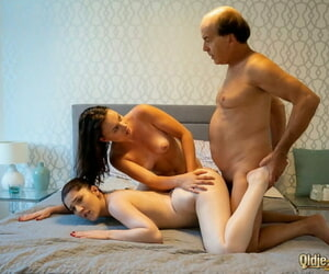 Teen girls attempt a threesome exceeding a bed with a older freeman
