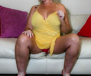 Nerdy flaxen-haired MILF Dee Siren removes her panic-stricken clothing and flaunts her pair