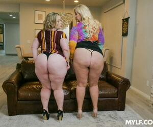 Bubble butted pornstars Lila Lovely and Bunny De La Cruz strip and share a BBC