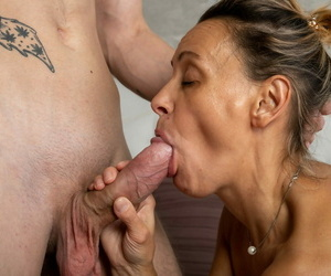 Old amateur receives a facial cumshot after fucking her young stepson