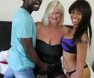 Granny Lacey Starr having a immoral FFM trine close by a black couple