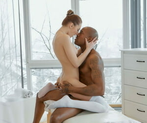 Teen in white stockings Katy Rose massages a ebony man before riding his cock