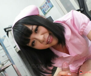 Dark haired Asian nurse Yui Nozomi kneels and gives head on the floor