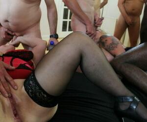 Peaches granny Lacey Starr enjoying an interracial gangbang in nylons