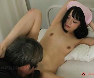 Hot Asian nurse Yui Nozomi lets a patient rub her trimmed pussy then fucks him