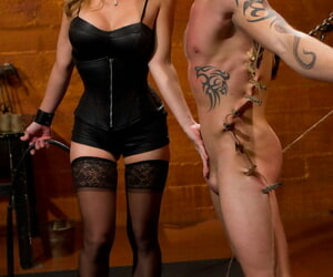 Dirty domme in lacy stockings Felony abuses a tied up guys dick