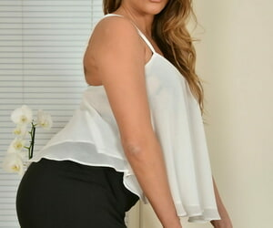 Leggy 30 plus UK woman Lady Teresa gets naked in her office with glasses on
