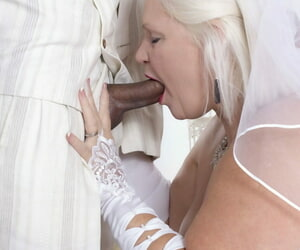 Mature bride Lacey Starr blows off her black groom after the wedding ceremony