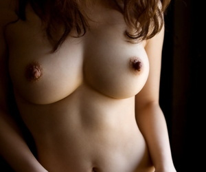 Beautiful Japanese girl Maiko Kazano uncovers her great tits as she gets naked