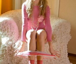 Sultry pigtailed teen with regard to socks oils her pussy of hot vilification session