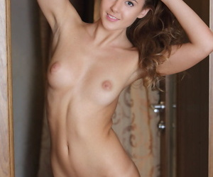 Teen solo girl Sybil A showcases her landing strip pussy while totally naked
