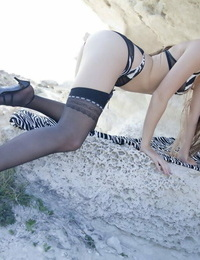 Euro horny teen Milena D tugging panties to reveal bald pussy on the beach