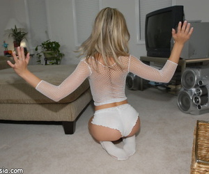 Young blonde Kasia teases in white underwear and socks in a see thru mesh top