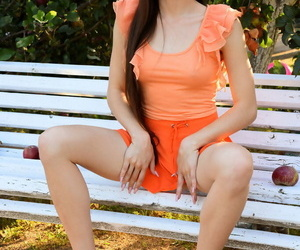Leggy teen Lola Cherie gets assuredly nude on a outside of under an apple tree