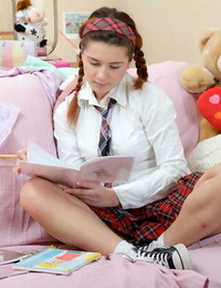 Cute schoolgirl with her hair in pigtails toys her asshole while masturbating