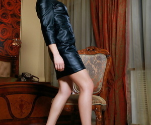 Redhead babe Violla A shedding leather dress during glamour photo spread