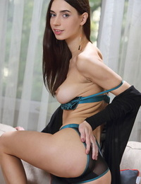 Skinny young brunette Dita Vreveals her bald pussy lips while spreading naked