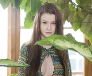 Beautiful young girl Emily Bloom posing in knee socks for glamour shoot