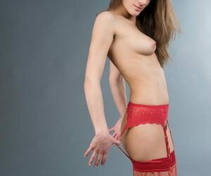 Young girlfriend Penelope B playfully removes red interlace stockings and garters