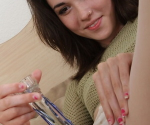 Teen Emily Grey with glasses dildo starts with clit and then pushes squarely medial