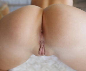 Blonde solo model Zoey Taylor pleasures her shaved pussy with fingers and toys