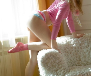 Adorable teen with an nuisance to die for fingers the brush penurious comminute a break up with wearing pink socks