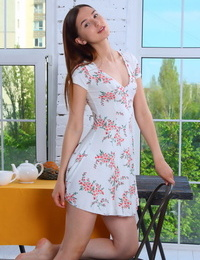 Petite teen Milana removes summer dress and panties for great nude poses