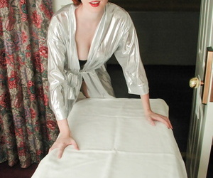 Natural redhead Elli Nude sheds a satin robe before draping her twat in pearls