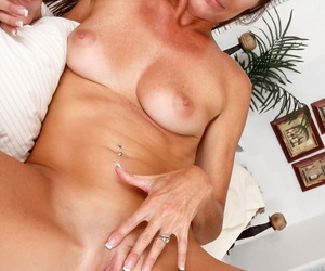 Tall middle-aged lady Sofie Marie tugs on her labia lips to part her snatch
