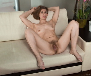 Middle-aged lady showcases her hairy bush once her clothes come off