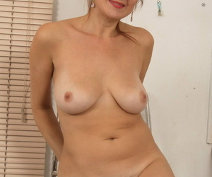 Older housewife toys her natural pussy after getting naked in kitchen