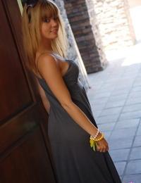 Cute teen girl Diddylicious slips her long dress over her tight ass