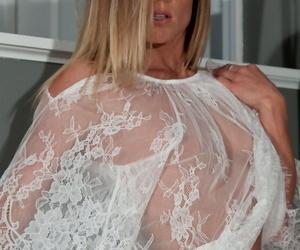 Leggy blond MILF Meet Madden modeling for softcore set in see thru lingerie