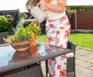 Amateur model Toni T exposes her huge tits on backyard patio