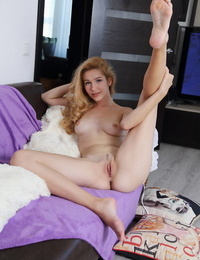 Blonde solo girl Genevieve Gandi spreading trimmed twat for glamour pics