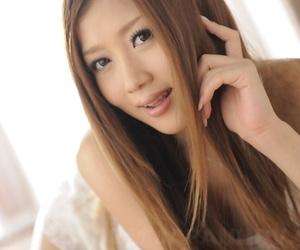 Beautiful Japanese girl Uta Kohaku lets a nip slip in satin lingerie
