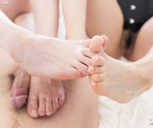 2 Japanese girls uses their pliable bare feet to jack off a cock
