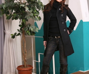 Japanese piece of baggage connected with a pretty face models non divest in a black coat increased by jeans