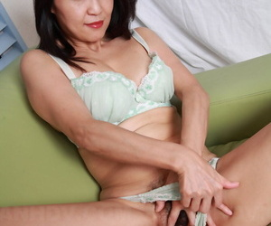 Japanese lady sticks her hand down her underwear for solo masturbation action