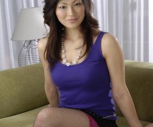 Hot Japanese Rio Saski in fishnets flashes nice medium tits & sexy panties