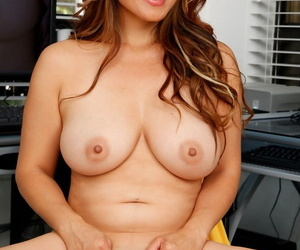 Asian American lady Lucy Page uncovers her big naturals as she disrobes