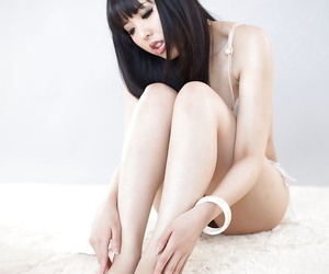 Young Asian Japanese girl in stockings undressing to suck her bare toes
