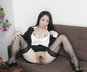 Beautiful Japanese woman Ai Mizushima shows her trimmed muff in seamed hosiery