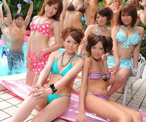 Adorable Japanese girlfriends in XXX swimsuits flaunt their beauty poolside