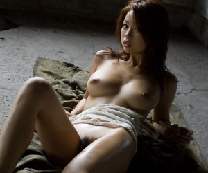 Japanese babe Risa Kasumi rocks the brush constant breasts while modelling unadorned