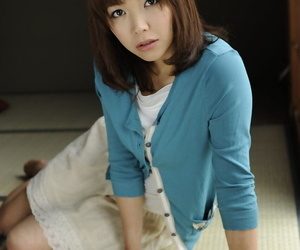 Japanese solo catholic Juri Kitahara tentatively shows her trimmed pussy