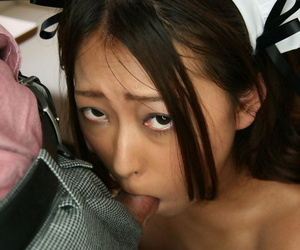 Japanese maid has her pussy stimulated while getting face fucked