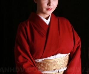 Japanese model Yuki Tsukamoto fondles her firm boobs as she gets naked