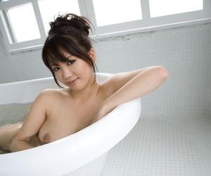 Beautiful Japanese girl Mai Nadasaka gets naked before soaking in a bathtub