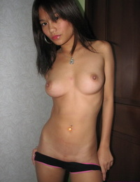 Young Asian girl removes cute panties to get completely naked